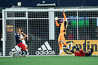 FOXBOROUGH, MA - MAY 1: Brad Guzan #1 Goalkeeper of Atlanta United FC saves a shot on goal during a game between Atlanta United FC and New England Revolution at Gillette Stadium on May 1, 2021 in Foxborough, Massachusetts.