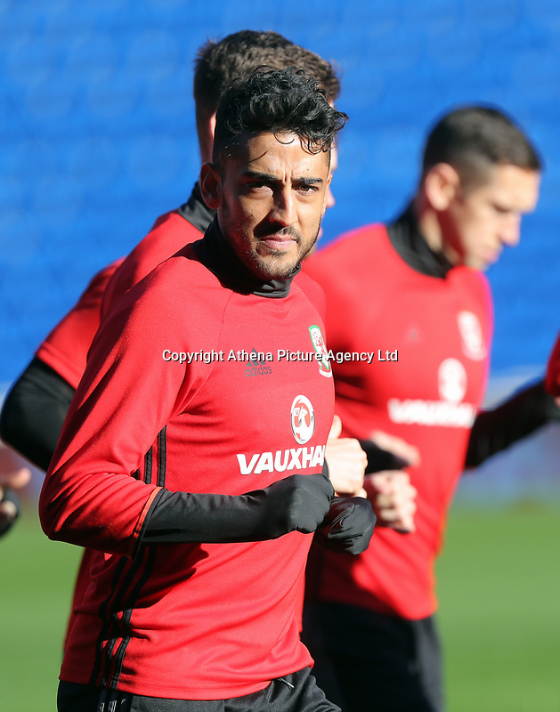 Neil Taylor warms up with team mates during the Wales Press Conference and Training Session at The Cardiff City Stadium, Wales, UK. Monday 13 November 2017