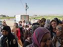 Iraq 2013 .Day of shopping for refugees queuing up in front the supermarket near Domiz camp. Irak 2013.Des  refugies du camp de Domiz font la queue devant le supermarche a cote du camp