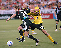 DC United defender Bryan Namoff (26) fighting for control of the ball against Columbus Crew midfielder Eddie Gaven (12) during the game. DC United defeated the Columbus Crew 3-2, Saturday, July 15, 2006.
