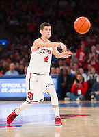 NEW YORK, NY - Sunday December 13, 2015: Federico Mussini (#4) of St. John's passes the ball to the outside.  St. John's defeats Syracuse 84-72 during the NCAA men's basketball regular season at Madison Square Garden in New York City.