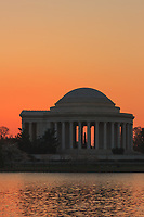 Jefferson Memorial against a pink/magenta sky prior to sunrise in Washington, DC