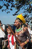 Kayapo Chief Raoni carries his warclub and walks with a group of children at the People's Summit, United Nations Conference on Sustainable Development, Rio de Janeiro, Brazil.