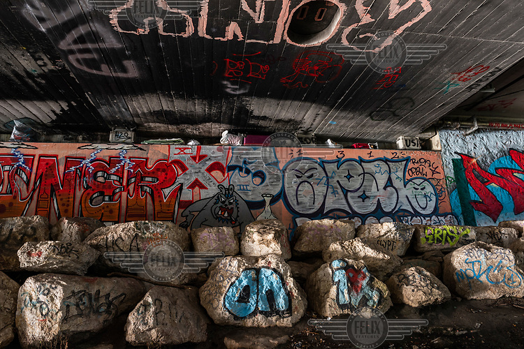 Homeless people's belongings hidden under the eaves of the Pont des Acasias, beside the Arve River where they sleep. Street cleaners will remove any belongings not carefully stowed away.