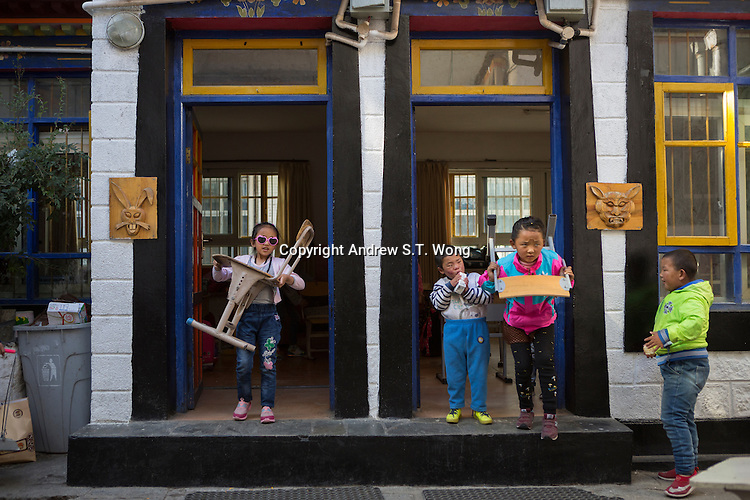 Blind and visually impaired Tibetan students arrange seats for a disciplinary session at the School for the Blind in Tibet, in the capital city of Lhasa, September 2016.