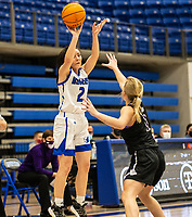 Aubrey Treadwell (2) of Rogers takes the 3 point shot, with Claudia Bridges (1) of Fayetteville defending at King Arena, Rogers, AR January 8, 2021 / Special to NWA Democrat-Gazette/ David Beach