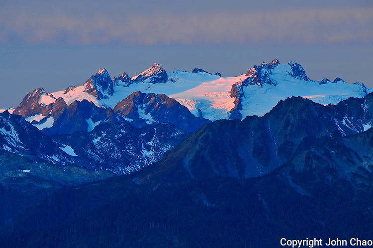 Sunrise light colors the Bailey Range as viewed from Hurricane Ridge, Olympic National Park, Washington State
