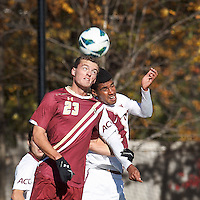 Boston College forward Cole DeNormandie (23) and Virginia Tech midfielder Andre Thomas (5) battle for head ball. Boston College (maroon) defeated Virginia Tech (Virginia Polytechnic Institute and State University) (white), 3-1, at Newton Campus Field, on November 3, 2013.