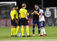 LAKE BUENA VISTA, FL - JULY 26: Alan Pulido of Sporting KC and Russell Teibert of Vancouver Whitecaps FC bump fists after the coin toss during a game between Vancouver Whitecaps and Sporting Kansas City at ESPN Wide World of Sports on July 26, 2020 in Lake Buena Vista, Florida.