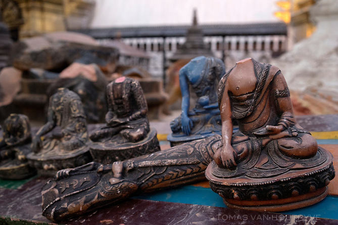 Broken statues are seen at Swayambhunath, in Kathmandu, Nepal in June 2015. The main stupa structure survived the earthquake, but the surrounding monasteries and 17th century buildings collapsed, damaging Buddhist and Hindu statues and ancient sacred artifacts. Monks and caretakers were forced to move into tents.