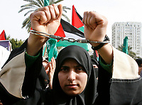 "A Palestinian Hamas supporter handcuffs herself during a protest calling for an end to Israeli sanctions on Gaza February 23, 2008.""photo by Fady Adwan"""