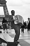 Accordion player at the Eiffel Tower. Paris, France. July 28, 2007.