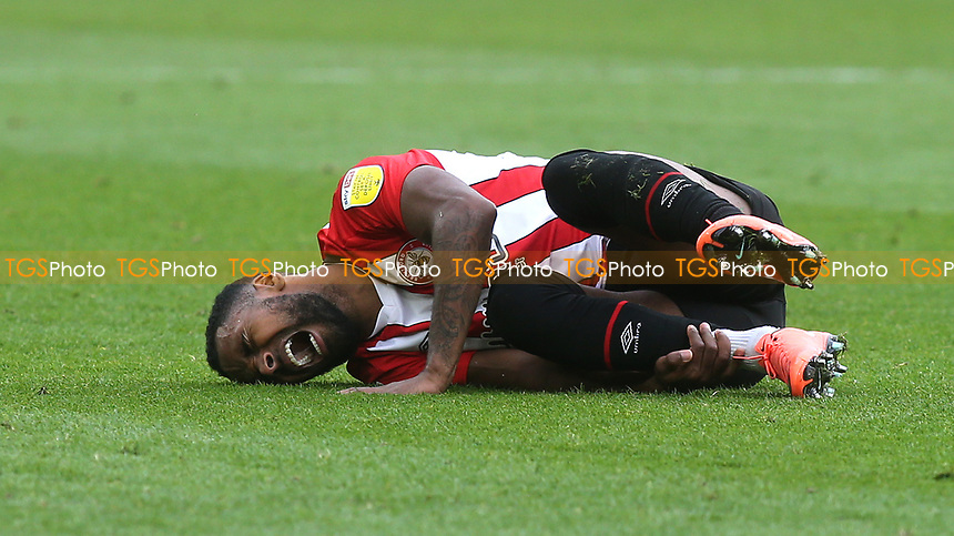 Brentford's Rico Henry feels the pain after suffering an injury during Brentford vs Coventry City, Sky Bet EFL Championship Football at the Brentford Community Stadium on 17th October 2020
