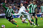 Rafa Navarro of Real Betis competes for the ball with Isco Alarcon of Real Madrid  during the match of Spanish La Liga between Real Madrid and Real Betis at  Santiago Bernabeu Stadium in Madrid, Spain. March 12, 2017. (ALTERPHOTOS / Rodrigo Jimenez)