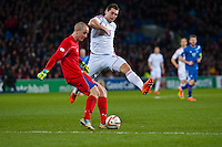 Wednesday 05 March 2014<br /> Pictured:Sam Vokes tries to block Hannes Thor Halldorssonz, the Iceland goalkeeper<br /> Re: International friendly Wales v Iceland at the Cardiff City Stadium, Cardiff,Wales UK
