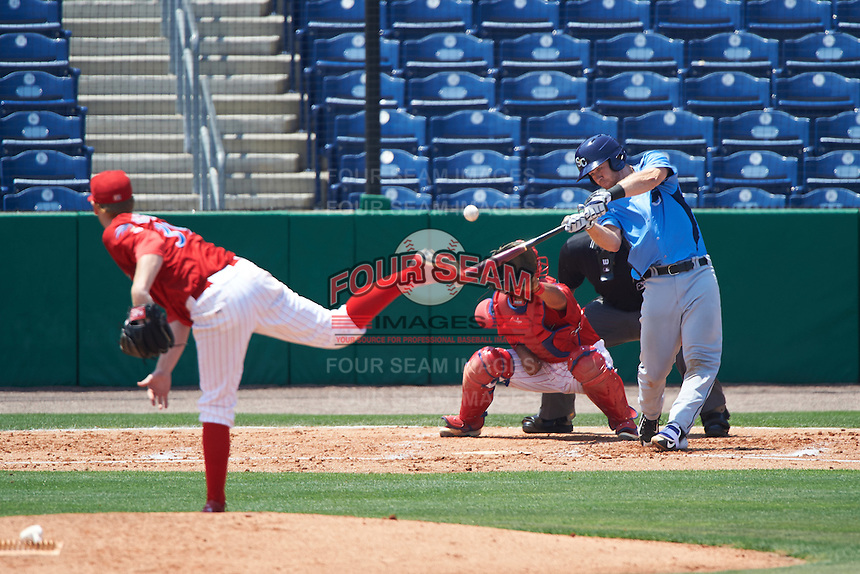 Charlotte Stone Crabs catcher Mac James (8) connects on a pitch from Tom Eshelman (39) while at bat in front of catcher Chace Numata (50) and umpire Mike Savakinas during a game against the Clearwater Threshers on April 13, 2016 at Bright House Field in Clearwater, Florida.  Charlotte defeated Clearwater 1-0.  (Mike Janes/Four Seam Images)
