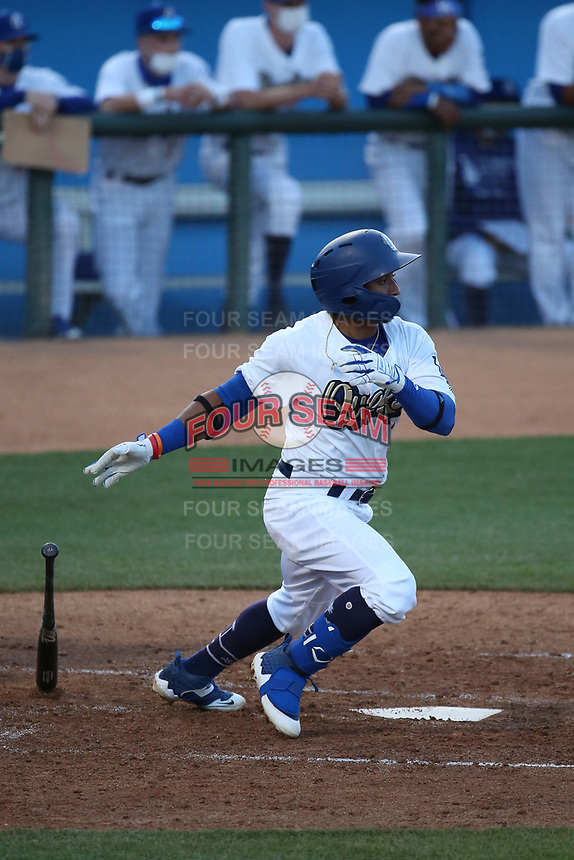 Edwin Mateo (7) of the Rancho Cucamonga Quakes bats against the Modesto Nuts at LoanMart Field on May 14, 2021 in Rancho Cucamonga, California. (Larry Goren/Four Seam Images)