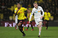 (L-R) Marvin Zeegelaar of Watford runs next to Oliver McBurnie of Swansea City during the Premier League match between Watford and Swansea City at the Vicarage Road, Watford, England, UK. Saturday 30 December 2017