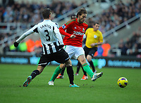 Saturday 17 November 2012<br /> Pictured: Michu of Swansea (R) manages to pass the ball past Davide Santon of Newcastle (L)<br /> Re: Barclay's Premier League, Newcastle United v Swansea City FC at St James' Park, Newcastle Upon Tyne, UK.