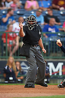 Umpire Jose Esteras makes a call during a game between the Pensacola Blue Wahoos and Mississippi Braves on May 28, 2015 at Trustmark Park in Pearl, Mississippi.  Mississippi  defeated Pensacola 4-2.  (Mike Janes/Four Seam Images)