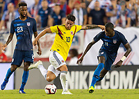 Tampa, FL - Thursday, October 11, 2018: Kellyn Acosta, James Rodriguez, Timothy Weah during a USMNT match against Colombia.  Colombia defeated the USMNT 4-2.