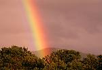 A rainbow over the Sangre de Cristo Mountains, New Mexico.