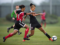 Lianne Sanderson (10) of the D.C. United Women passes the ball away from Jessica Kalonji (21) of the Virginia Beach Piranhas during the game at the Maryland SoccerPlex in Boyds, Maryland.  The D.C. United Women defeated the Virginia Beach Piranhas, 3-0, to advance to the W-League Eastern Conference Championship.