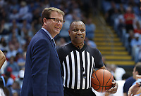 CHAPEL HILL, NC - FEBRUARY 25: Official Michael Stephens and senior associate athletic director Clint Gwaltney of the University of North Carolina during a game between NC State and North Carolina at Dean E. Smith Center on February 25, 2020 in Chapel Hill, North Carolina.