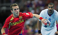 08 AUG 2012 - LONDON, GBR - Victor Tomas Gonzalez (ESP) of Spain (left) takes a 7-metre throw during the men's London 2012 Olympic Games quarter final match against France at the Basketball Arena in the Olympic Park, in Stratford, London, Great Britain .(PHOTO (C) 2012 NIGEL FARROW)