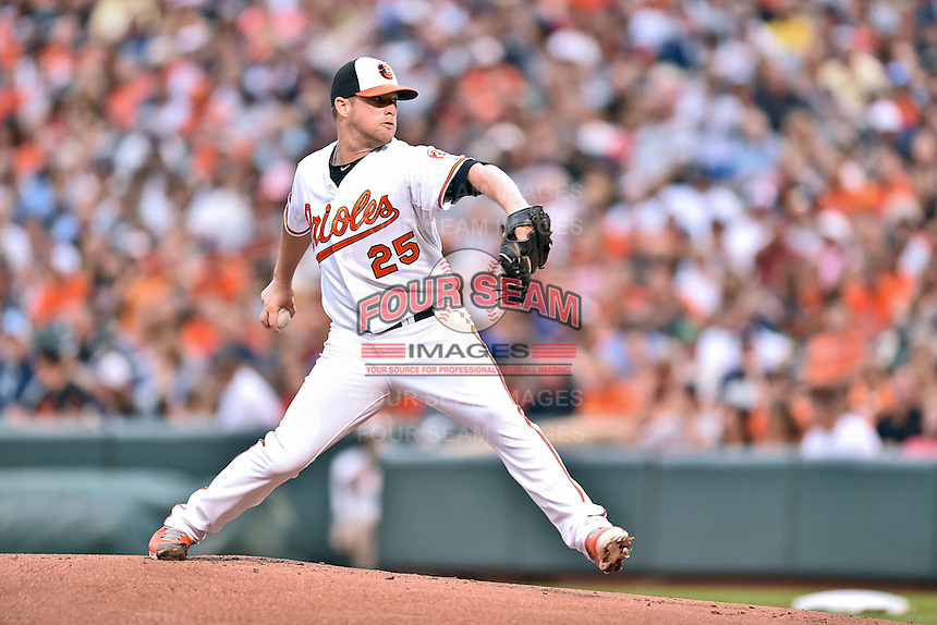 Baltimore Orioles starting pitcher Bud Norris #25 delivers a pitch during a game against the New York Yankees at Oriole Park at Camden Yards August 11, 2014 in Baltimore, Maryland. The Orioles defeated the Yankees 11-3. (Tony Farlow/Four Seam Images)