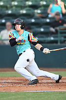 Matt Whatley (19) of Las Llamas de Hickory follows through on his swing during a game against Los Rapidos de Kannapolis at L.P. Frans Stadium on July 17, 2019 in Hickory, North Carolina. The Llamas defeated the Rapidos 7-5. (Tracy Proffitt/Four Seam Images)