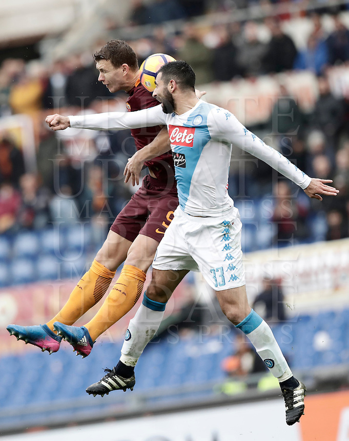 Roma's Edin Dzeko, left, and Napoli's Raul Albiol jump for the ball during the Italian Serie A football match between Roma and Napoli at Rome's Olympic stadium, 4 March 2017. <br /> UPDATE IMAGES PRESS/Isabella Bonotto