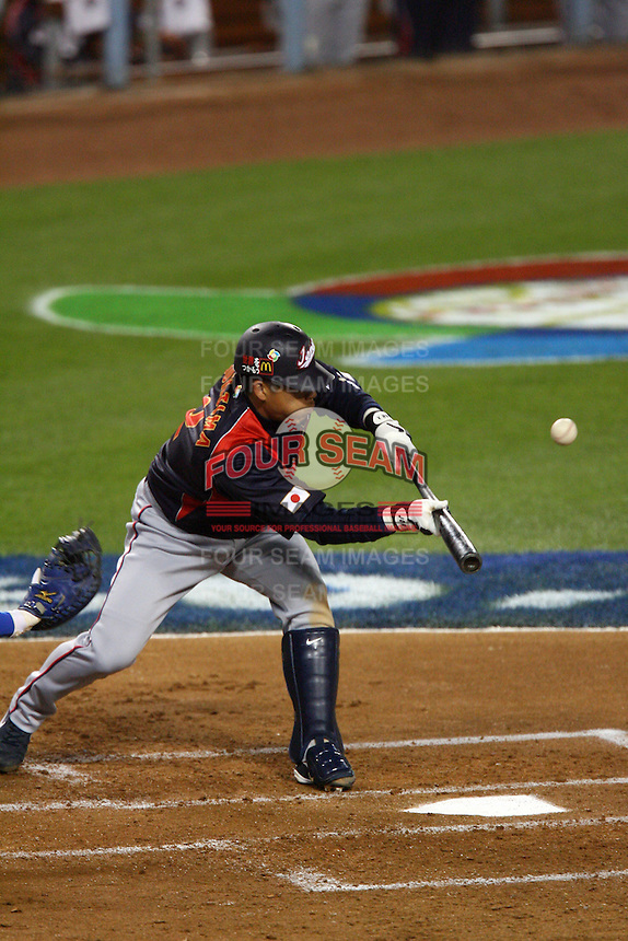Kenji Johjima of Japan during a game against Korea at the World Baseball Classic at Dodger Stadium on March 23, 2009 in Los Angeles, California. (Larry Goren/Four Seam Images)