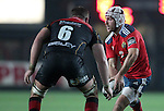 Johne Murphy of Munster Rugby is challenged by Blind-side flanker James Thomas of Newport Gwent Dragons.<br /> <br /> Guinness Pro 12<br /> Newport Gwent Dragons v Munster Rugby<br /> Rodney Parade<br /> 21.11.14<br /> ©Steve Pope-SPORTINGWALES