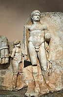 Close up of a Roman Sebasteion relief  sculpture of Emperor Nero with captive, Aphrodisias Museum, Aphrodisias, Turkey.  Against an art background.<br /> <br /> Naked warrior emperor Nero holds the orb of world rule in one hand and crowns the military trophy with the other. Between the trophy and the emperor stands a bound captive boy. He wears long barbarian trousers and looks up at Nero.