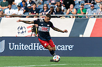 FOXBOROUGH, MA - AUGUST 8: Gustavo Bou #7 of New England Revolution crosses the ball during a game between Philadelphia Union and New England Revolution at Gillette Stadium on August 8, 2021 in Foxborough, Massachusetts.