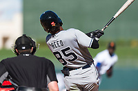 Peoria Javelinas left fielder Buddy Reed (85), of the San Diego Padres organization, follows through on his swing in front of home plate umpire Brennan Miller during an Arizona Fall League game against the Surprise Saguaros at Surprise Stadium on October 17, 2018 in Surprise, Arizona. (Zachary Lucy/Four Seam Images)
