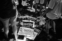 Signs for the campaign of Republican presidential candidate Mitt Romney lay on the ground after the 4th of July parade in Amherst, New Hampshire. Republican presidential candidates Mitt Romney and Jon Huntsman walked in the parade as part of their campaign for the 2012 presidential election.
