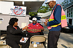 May 6, 2008. Durham, NC.. With the close North Carolina primary battle between Senators Hillary Clinton and Barack Obama, voters hit the polls to try and bring closure to this highly contested state and divide the delegates between the 2 candidates.. (l to r) Georgia G. Harris and Charles B. Leslie talk to a friend about his options or voting. They sat outside the limits for campaign literature distribution as they were pushing a Democratic ticket, including Senator Barack Obama. They have been working elections since the 1960's.