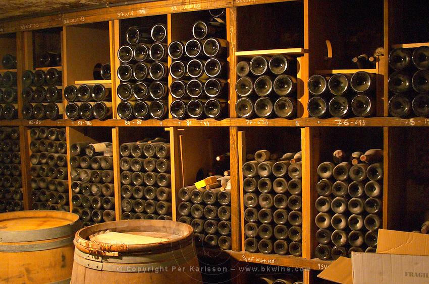 Older vintages of wine aging in the cellar. Alain Voge, Cornas, Ardeche, Ardèche, France, Europe