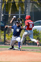 New York Yankees first baseman Matt Snyder #29 takes a throw as Alejando Villalobos #19 runs through the bag during a minor league Spring Training game against the Philadelphia Phillies at Carpenter Complex on March 21, 2013 in Clearwater, Florida.  (Mike Janes/Four Seam Images)