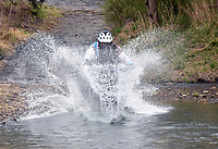 BIG SPLASH ATTACK<br />Craig Franzen of Highfill rides his bike at break-neck speed into chilly Lee Creek on Saturday April 3 2021 during the Big Splash Contest at the 32nd annual Ozark Mountain Bike Festival at Devil's Den State Park. Contestants got extra points for spashing down in costume and Franzen sported a 3-foot-long fake beard during his run. The festival also featured guided group mountain bike rides for beginner and experienced riders, instructional rides to improve riding technique, bike limbo and a skills course for kids. Riders were also allowed to pedal over some of the new trails in the park that will not officially open for about a month. Go to nwaonline.com/210404Daily/ to see more photos.<br />(NWA Democrat-Gazette/Flip Putthoff)