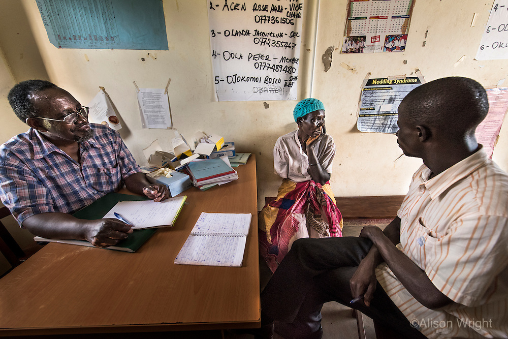 "N. Uganda, Gulu District. Joshua Tugumisirize, a visiting PCAF psychiatrist & Freddy Odong, a PCAF nN. Uganda, Gulu District. Joshua Tugumisirize, a visiting PCAF psychiatrist & Freddy Odong, a PCAF (Peter C. Alderman Foundation) nurse, perform a psychiatric assessment and counseling at the local rural clinic in Gulu. ""Ruth"" lost her arm during the war and struggles with depression due to her circumstances. She has no husband but a young son helps her at home. ""Ruth"" walks many miles to come to the rural clinic where she gets periodic counseling & treatment from a PCAF nurse and social worker. urse, perform a psychiatric assessment and counseling at the local rural clinic in Gulu. ""Ruth"" lost her arm during the war and struggles with depression. She has no husband but a young son helps her. ""Ruth"" walks many miles to come to the rural clinic where she gets periodic counseling & treatment. It took nearly an hour just to drive to her home."