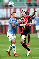Ciro Immobile of SS Lazio nad Alessio Romagnoliof AC Milan compete for the ball during the Serie A 2021/2022 football match between AC Milan and SS Lazio at Giuseppe Meazza stadium in Milano (Italy), August 29th, 2021. Photo Image Sport / Insidefoto
