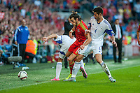 Gareth Bale  of Wales  ( Centre ) battles to keep the ball in during their UEFA EURO 2016 Group B qualifying round match held at Cardiff City Stadium, Cardiff, Wales, 06 September 2015. EPA/DIMITRIS LEGAKIS