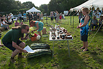 Cudham Kent. Village summer fete Kent Uk Village produce, silver cups, flowers all in competition. Judges judging under the watchful eye of the Lady >ayor. 2017