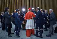 New Cardinal, Italian prelate Matteo Maria Zuppi (C) looks on as he meets with relatives and friends during a courtesy visit following his appointment by the Pope, during an Ordinary Public Consistory for the creation of new cardinals on October 5, 2019 in the Vatican. Pope Francis appoints 13 new cardinals at the 2019 Ordinary Public Consistory, choosing prelates whose lifelong careers reflect their commitment to serve the marginalized and local church communities, hailing from 11 different nations and representing multiple religious orders.