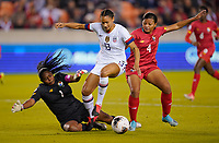 HOUSTON, TX - JANUARY 31: Lynn Williams #13 of the United States battles with Panama's GK Yenith Bailey #1 and Hilary Jean #4 for the ball during a game between Panama and USWNT at BBVA Stadium on January 31, 2020 in Houston, Texas.