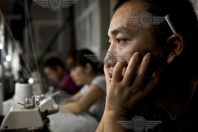 39 year old Mr Shi supervises rural migrants working in a garment sweatshop on the outskirts of the southwestern Chinese megapolis of Chongqing. They often work through the nights, earning 1,000 - 6,000 yuan per month depending on work load, a decent income compared with subsistence farming. Mr Shi is also from the country side. For many, this is a long and arduous step in the transition from farming to urban living. China is hoping by relocating farmers into cities they would start to buy food, making a break from the cycle of farmers consuming only what they produce. The Chinese government plans to move 250 million rural residents into urban areas over the coming dozen years though it is unclear whether people want to move and where the money for this project will come from. Further urbanisation is meant to drive up consumption to counterbalance an export orientated economy and end subsistence farming but the drive to get people off the land is causing tens of thousands of protests each year. /Felix Features