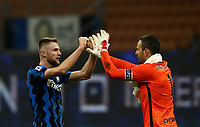 Calcio, Serie A: Inter Milano - Atalanta, Giuseppe Meazza (San Siro) stadium, in Milan, March 8, 2021.  <br /> Inter's Milan Skriniar (L)  elebrates with his captain the goalkeeper Samir Handanovic (R) after winning 1-0 the Italian Serie A football match between Inter and Atalanta at Giuseppe Meazza (San Siro) stadium, on  March 8, 2021.  <br /> UPDATE IMAGES PRESS/Isabella Bonotto
